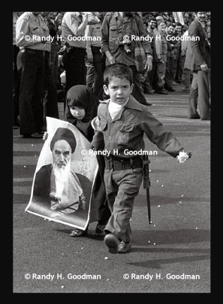 boy and girl with Khomeini poster